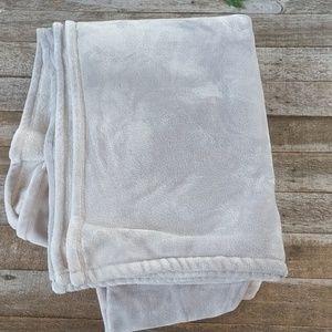 Twin size light gray DKNY fleece blanket